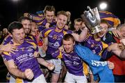 24 October 2014; Kilmacud Crokes players celebrate with the New Ireland Cup after the game. Dublin County Senior Hurling Championship Final, St Judes v Kilmacud Crokes, Parnell Park, Dublin. Picture credit: Pat Murphy / SPORTSFILE