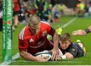 24 October 2014; Andrew Conway, Munster, goes over to score his side's first try, which was subsequently disallowed despite the tackle of Saracens, David Strettle. European Rugby Champions Cup 2014/15, Pool 1, Round 2, Munster v Saracens, Thomond Park, Limerick. Picture credit: Matt Browne / SPORTSFILE