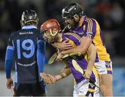 24 October 2014; Kilmacud Crokes' Ryan O'Dwyer and team-mate Jude Sweeney, right, celebrate at the final whistle while St. Judes' Vinnie Walsh looks on. Dublin County Senior Hurling Championship Final, St Judes v Kilmacud Crokes, Parnell Park, Dublin. Picture credit: Pat Murphy / SPORTSFILE