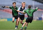 23 October 2014; Hugo McWade, St. Michael's, Ballsbridge, in action against Stephen Grogan, 6, and Ruairi Hogan, left, St. Joseph's, Terenure, during the Scaith na nGearaltach final. Allianz Cumann na mBunscol Finals, Croke Park, Dublin. Picture credit: Pat Murphy / SPORTSFILE