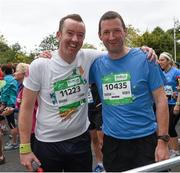 27 October 2014; Participants Jackie Cahill, from Portlaoise, Co. Laois, and former Tipperary hurling All-Star goalkeeper Brendan Cummins as they make their way up Fitzwilliam Place for the start of the SSE Airtricity Dublin Marathon 2014. Fitzwilliam Place, Dublin. Picture credit: Ray McManus / SPORTSFILE