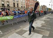 27 October 2014; Jerry Kiernan, himself a winner of the race in 1992, walks along Fitzwilliam Place as participants make their way up at the start of the SSE Airtricity Dublin Marathon 2014. Fitzwilliam Place, Dublin. Picture credit: Ray McManus / SPORTSFILE