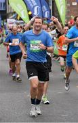 27 October 2014; Former Tipperary hurling All-Star goalkeeper Brendan Cummins on his way to finishing the SSE Airtricity Dublin Marathon 2014. Merrion Square, Dublin. Picture credit: Ray McManus / SPORTSFILE