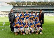 27 September 2014; President of the Camogie Association Aileen Lawlor and GAA Ard Stiúrthóir Paraic Duffy, with the Tipperary camogie team, back row, left to right, Caoimhe Forrest, Ballygunner N.S., Waterford City, Aine Corcoran,  Bailieborough Shamrocks GAA Club, Bailieborough, Co. Cavan, Carla O'Neill, St. Michael's P.S., Randalstown, Co. Antrim, Katie Boyle, Borrisoleigh N.S., Borrisoleigh, Co. Tipperary, Ellen Brennan, St Mary's Secondary School, Newport, Co. Tipperary, front row, left to right, Roisín Cahill, Coláiste na Trocaire, Rathkeale, Co. Limerick, Gráinne Curtin, Glenville N.S., Glenville, Co. Cork, Aimee Collins, Scoil Maelruain Senior, Old Bawn, Co. Dublin, Joanne Hickey, St. Michael's N.S., Mullinahone, Co. Tipperary, and Aisling Browne, Snugboro N.S., Castlebar, Co. Mayo. INTO/RESPECT Exhibition GoGames, Croke Park, Dublin. Picture credit: Dáire Brennan / SPORTSFILE