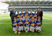 27 September 2014; President of the Camogie Association Aileen Lawlor and GAA Ard Stiúrthóir Paraic Duffy, with the Tipperary team, back row, left to right, James Lydon, Scoil Treasa, Firhouse, Co. Dublin, Cathal Fitzgerald, Watergrasshill GAA Club, Watergrasshill, Co. Cork, Eoghan O'Brien, Kilvemnon N.S., Mullinahone, Co. Tipperary, Niall Duffy, Birdhill N.S., Birdhill, Co. Tipperary, Josh Higgins, Tír na nÓg GAA Club, Randalstown, Co. Antrim, front row, left to right, Jake Nee, Leitrim Kilnadeema GAA Club, Loughrea, Co. Galway, Adam Clare, Clogherinkoe N.S., Broadford, Co. Kildare, Aaron Wymberry, St. Declan's N.S., Waterford City, Co. Waterford, Diarmuid Brennan, Carrig N.S., Birr, Co. Offaly, and Conal Hession, Aghamore N.S., Ballyhaunis, Co. Mayo. INTO/RESPECT Exhibition GoGames, Croke Park, Dublin. Picture credit: Dáire Brennan / SPORTSFILE