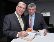 30 October 2014; Eugene McGee autographs his book for Martin Skelly, former Chairman of the Leinster Council, at the launch of his book 'The GAA in My Time' by Eugene McGee.  Croke Park, Dublin. Picture credit: Matt Browne / SPORTSFILE