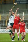 6 May 2007; Niamh Mulcahy, Limerick, in action against Regina Curtin, Cork. Camogie National League Division 1B Final, Cork v Limerick, Nowlan Park, Co. Kilkenny. Picture credit: Matt Browne / SPORTSFILE