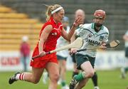 6 May 2007; Regina Curtin, Cork, in action against Niamh Mulcahy, Limerick. Camogie National League Division 1B Final, Cork v Limerick, Nowlan Park, Co. Kilkenny. Picture credit: Matt Browne / SPORTSFILE