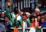 August 1992; Olympic Champion Michael Carruth pictured on board the bus which drove him through the streets of Dublin. Also included are his wife Paula and Nicholas Cruz. Boxing. Picture credit; David Maher/SPORTSFILE