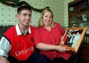6th January 2000;  Stephen Bradley Arsenal and Rep of Ireland, with his mother Bernie holding a picture of Stephen with Liam Brady at their home in Jobstown,Tallaght, Dublin. Soccer. Picture Credit ; David Maher/SPORTSFILE