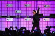6 November 2014; Bono, Musician, Elevation Partners, waves to the crowd at the centre stage during Day 3 of the 2014 Web Summit in the RDS, Dublin, Ireland. Picture credit: Ramsey Cardy / SPORTSFILE / Web Summit