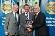 8 November 2014; Referee Patrick Fox, from Westmeath, is presented with his retiring referees' award by Pat McEnaney, Chairman of National Referee Committee, left, and Frank Burke, Vice- President of Gaa. 2014 National Referees' Awards Banquet, Croke Park, Dublin. Picture credit: Barry Cregg / SPORTSFILE