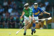 10 June 2007; Paul Storan, Limerick, in action against Peter Kennedy, Tipperary. Munster Intermediate Hurling Championship Semi-Final, Limerick v Tipperary, Gaelic Grounds, Limerick. Picture credit: Brendan Moran / SPORTSFILE