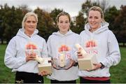 9 November 2014; Winner, Fionnuala Britton, Kilcoole A.C., Co. Wicklow with left, second place, Anne Marie McGlynn, Tir Chonaill A.C., Co. Donegal and right, third place, Ciara Durkin, Skerries A.C. The 2014 Remembrance Run 5K. Phoenix Park, Dublin. Picture credit: Tomás Greally / SPORTSFILE
