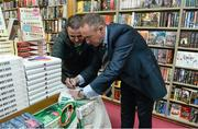 12 November 2014; Former Republic of Ireland international Alan McLoughlin, right, signs the jersey of Eddie O'Mahoney, Kilmacud, Dublin, at the launch of  'A Different Shade of Green. Dubray Bookshop, Grafton Street, Dublin. Picture credit: Barry Cregg / SPORTSFILE