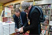 12 November 2014; Former Republic of Ireland international Alan McLoughlin, left, signs the book of Wilton Smith, right, from Cabra, Dublin, at the launch of  'A Different Shade of Green. Dubray Bookshop, Grafton Street, Dublin. Picture credit: Barry Cregg / SPORTSFILE