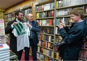 12 November 2014; Edward Gaffney, from Marino, Dublin, takes the picture of former Republic of Ireland international Alan McLoughlin, right, and Patrick Carroll, left, from Templeogue, Dublin, at the launch of  'A Different Shade of Green. Dubray Bookshop, Grafton Street, Dublin. Picture credit: Barry Cregg / SPORTSFILE