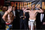 14 November 2014; Spike O'Sullivan weighs in for his middleweight bout, closely watched by opponent Anthony Fitzgerald, left. Citywest Hotel, Saggart, Co. Dublin. Picture credit: Ramsey Cardy / SPORTSFILE