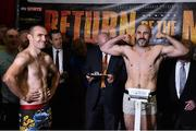 14 November 2014; Spike O'Sullivan, weighs in for his middleweight bout, closely watched by opponent Anthony Fitzgerald, left. Citywest Hotel, Saggart, Co. Dublin. Picture credit: Ramsey Cardy / SPORTSFILE