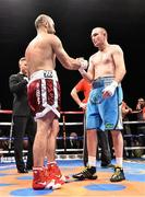 15 November 2014; Gary 'Spike' O'Sullivan, left, shakes hand with Anthony Fitzgerald after winning  their middleweight bout by first round knockout. Return of The Mack, 3Arena, Dublin.  Picture credit: Ramsey Cardy / SPORTSFILE