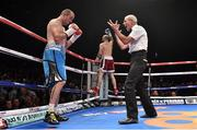 15 November 2014; Referee Micky Vann reaches a ten count on Anthony Fitzgerald during the first round as Gary 'Spike' O'Sullivan celebrates in the background at the end of their middleweight bout. Return of The Mack, 3Arena, Dublin.  Picture credit: Ramsey Cardy / SPORTSFILE