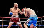 15 November 2014; Gary 'Spike' O'Sullivan, left, catches  Anthony Fitzgerald with a left hook on his way to a knockout during the first round of their middleweight bout. Return of The Mack, 3Arena, Dublin.  Picture credit: Ramsey Cardy / SPORTSFILE