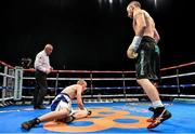 15 November 2014; John Joe Nevin, right, knocks down Jack Heath in the first round of their featherweight bout. Return of The Mack, 3Arena, Dublin. Picture credit: Ramsey Cardy / SPORTSFILE