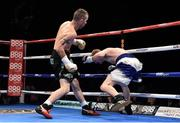 15 November 2014; John Joe Nevin, left, knocks down Jack Heath in the first round of their featherweight bout. Return of The Mack, 3Arena, Dublin. Picture credit: Ramsey Cardy / SPORTSFILE