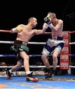 15 November 2014; John Joe Nevin, left, exchanges punches with Jack Heath during their featherweight bout. Return of The Mack, 3Arena, Dublin. Picture credit: Ramsey Cardy / SPORTSFILE