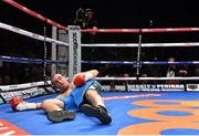15 November 2014; Anthony Fitzgerald lies on the canvas after being knocked out during the first round of his  middleweight bout against Gary 'Spike' O'Sullivan. Return of The Mack, 3Arena, Dublin.  Picture credit: Ramsey Cardy / SPORTSFILE