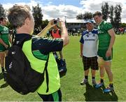 16 November 2014; Darren Hughes and Paddy Quinn, Killanny, Co Monaghan, have a picture taken by Dr Kevin Moran after the game. VFL Selection v Ireland - International Rules warm-up match, Sandringham VFL Ground, Trevor Barker Beach Oval, Melbourne, Victoria, Australia. Picture credit: Ray McManus / SPORTSFILE