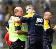 30 June 2007; Clare manager Tony Considine commiserates with Antrim joint manager Terence McNaughton after the final whistle. Guinness All-Ireland Hurling Championship Qualifier, Group 1A, Round 1, Antrim v Clare, Casement Park, Belfast, Co. Antrim. Picture credit: Oliver McVeigh / SPORTSFILE