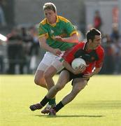 7 July 2007; Dan Gordon, Down, in action against Kevin Reilly, Meath. Bank of Ireland All-Ireland Senior Football Championship Qualifier, Round 1, Down v Meath, Pairc Esler, Newry, Co. Down. Picture credit: Oliver McVeigh / SPORTSFILE