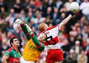 14 July 2007; Colin Devlin, Derry, gets his hand to the ball ahead of David Clarke, Mayo, for his side's first goal. Bank of Ireland All-Ireland Football Championship Qualifier, Round 2, Derry v Mayo, Celtic Park, Derry. Picture credit: Oliver McVeigh / SPORTSFILE