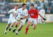 14 July 2007; Ken Donnelly, Kildare, in action against Peter McGinnity, Louth. Bank of Ireland All-Ireland Football Championship Qualifier, Round 2, Kildare v Louth, St. Conleth's Park, Newbridge, Co. Kildare. Picture credit: Matt Browne / SPORTSFILE