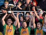 23 November 2014; Corofin captain Michael Farragher, left, lifts the Shane McGettigan cup, as he celebrate's with team-mate's Michael Lundy, centre and Cathal Silke. AIB Connacht GAA Football Senior Club Championship Final, Ballintubber v Corofin. Elvery's MacHale Park, Castlebar, Co. Mayo. Picture credit: David Maher / SPORTSFILE