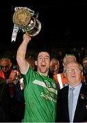 23 November 2014; Kilmallock captain Graeme Mulcahy lifts the cup, in the company of Robert Frost, Chairman of the Munster Council, after defeating Cratloe. AIB Munster GAA Hurling Senior Club Championship Final, Kilmallock v Cratloe. Gaelic Grounds, Limerick. Picture credit: Diarmuid Greene / SPORTSFILE