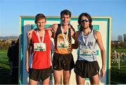 23 November 2014; Race winner Paul Pollock, Antrim, centre, second placed Mark Hanrahan, Cork, left, and third placed Michael Clohisey, Dublin, on the podium after the Senior Mens 10,000m race at the GloHealth Inter County & Juvenile Even Age Cross Country Championships. Dundalk Institute of Technology, Dundalk, Co. Louth. Picture credit: Ramsey Cardy / SPORTSFILE