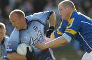 4 April 2004; Shane Ryan of Dublin is tackled by Niall Sheridan of Longford during the Allianz Football League Division 1A Round 7 match between Dublin and Longford at Parnell Park in Dublin. Photo by Pat Murphy/Sportsfile