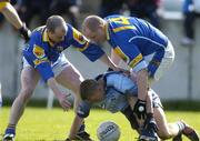 4 April 2004; Stephen O'Shaughnessy of Dublin in action against Padraic Davis, left, and Niall Sheridan of Longford during the Allianz Football League Division 1A Round 7 match between Dublin and Longford at Parnell Park in Dublin. Photo by Pat Murphy/Sportsfile
