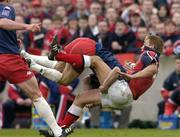 10 April 2004; Shaun Payne of Munster is tackled by Christophe Dominici of Stade Francais during the Heineken Cup Quarter-Final match between Munster and Stade Francais at Thomond Park in Limerick. Photo by Ray McManus/Sportsfile