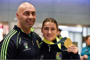 25 November 2014; Team Ireland's Katie Taylor with coach and father Pete Taylor pictured in Dublin Airport on their return from the 2014 AIBA Elite Women's World Boxing Championships in Jeju, Korea. Dublin Airport, Dublin. Picture credit: Barry Cregg / SPORTSFILE