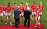 28 September 2014; Pat Quill, President, Ladies Gaelic Football Association, left, and President of Ireland Michael D. Higgins, are introduced to members of the Cork team by their captain Briege Corkery before the game. TG4 All-Ireland Ladies Football Senior Championship Final, Cork v Dublin. Croke Park, Dublin. Picture credit: Ray McManus / SPORTSFILE