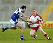 28 July 2007; Colin Devlin, Derry, in action against Cathal Ryan, Laois. Bank of Ireland All-Ireland Senior Football Championship Qualifier, Round 3, Laois v Derry, Kingspan Breffni Park, Cavan. Picture credit: Ray Lohan / SPORTSFILE