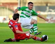 21 July 2014; Robert Bayly, Shamrock Rovers, in action against John Kavanagh, Cork City. EA Sports Cup, Quarter-Final, Shamrock Rovers v Cork City, Tallaght Stadium, Tallaght, Co. Dublin. Picture credit: David Maher / SPORTSFILE