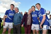 12 October 2014; Cratloe players, and brothers, from left to right, Sean Collins, Padraic Collins, and David Collins celebrate with their grandparents Annette and Cyril Collins after victory over Eire Og. Clare County Senior Football Championship Final, Cratloe v Eire Og. Cusack Park, Ennis, Co. Clare. Picture credit: Diarmuid Greene / SPORTSFILE