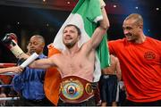 13 December 2014; Andy Lee, centre, celebrates with trainer Adam Booth, right, after his victory against Matt Korborov. WBO middleweight title fight. The Cosmopolitan, Las Vegas, NV, USA. Picture credit: Joe Camporeale / SPORTSFILE
