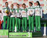 14 December 2014; The Ireland's women's team, from left to right, Sara Treacy, Ann-Marie McGlynn, Fionnuala Britton, Michelle Finn, Siobhan O'Doherty and Laura Crowe, after winning bronze in the Women's team event. Spar European Cross Country Championships, Samokov, Bulgaria. Picture credit: Ramsey Cardy / SPORTSFILE