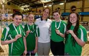 14 December 2014; Medallists, from  left, Emma Reid, Zoe Thompson, Bethany Firth and Mary Kate McDowell, Gold Medal winners in the Womens 400M Freestyle relay, representing Ards swimming club, along with former Irish Olympic swimmer Melanie Nocher at  Day 3 of the Irish Short Course Swimming Championships. Lagan Valley LeisurePlex, Lisburn, Co. Antrim. Picture credit: Oliver McVeigh / SPORTSFILE