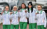 15 December 2014; Team Ireland athletes, who won team bronze medals in the Senior Women's event, from left, Fionnuala Britton, Ann Marie McGlynn, Siobhan O'Doherty, Laura Crowe and Michelle Finn in Dublin Airport on their return home from the Spar European Cross Country Championships in Bulgaria. Terminal 1, Dublin Airport, Dublin. Picture credit: Brendan Moran / SPORTSFILE